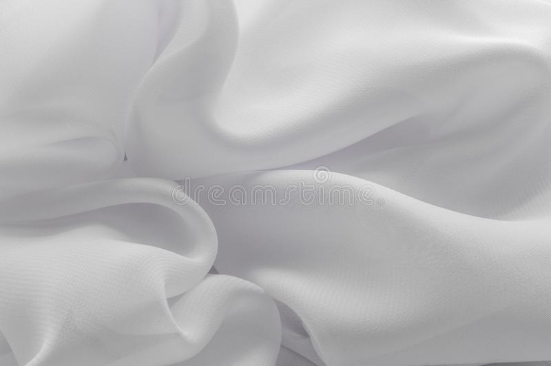 Texture, background, pattern. Silk fabric of white color, abstract folds. stock illustration