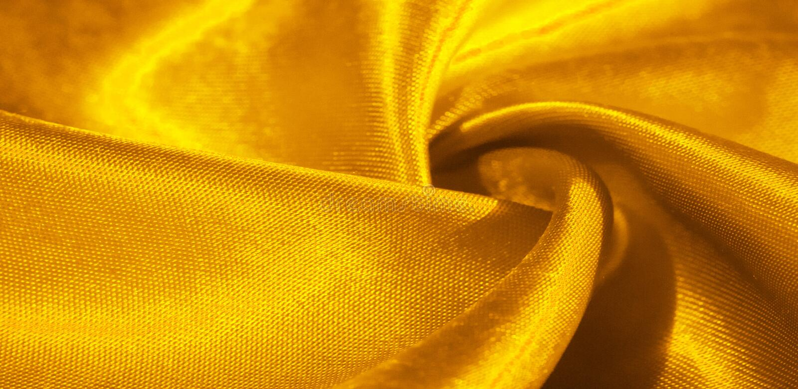 Texture, background, pattern, silk fabric in yellow. This adorable, soft and shiny fabric has a smooth mink surface, perfect for. Creating your projects royalty free stock photography