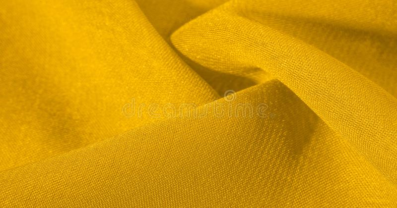 Texture, background, pattern, silk fabric in yellow. This silk is incredibly exquisite. Projects made from this will last a long t. Ime and will still be in royalty free illustration