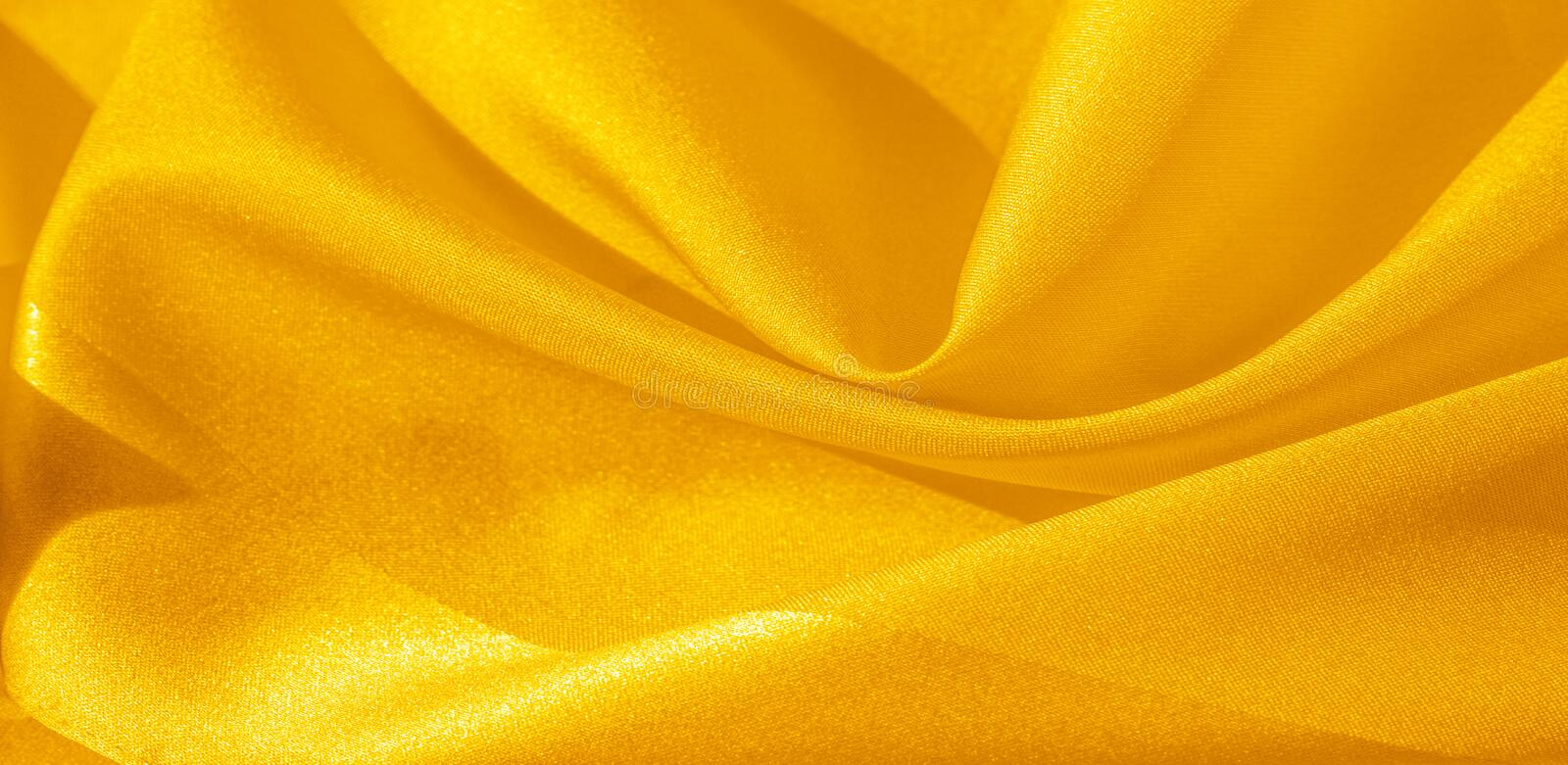 Texture, background, pattern, silk fabric in yellow. This silk is incredibly exquisite. Projects made from this will last a long. Time and will still be in stock photos