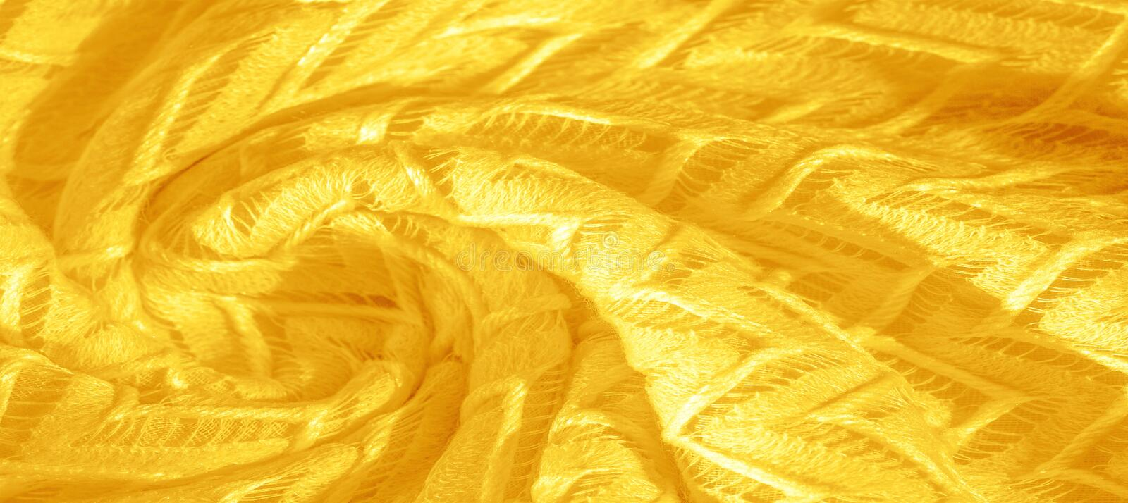 Texture, background, pattern, silk fabric, yellow, layered lace tulle, premium plain winter diamond knitted scarf in the form of. Infinity loops royalty free stock images
