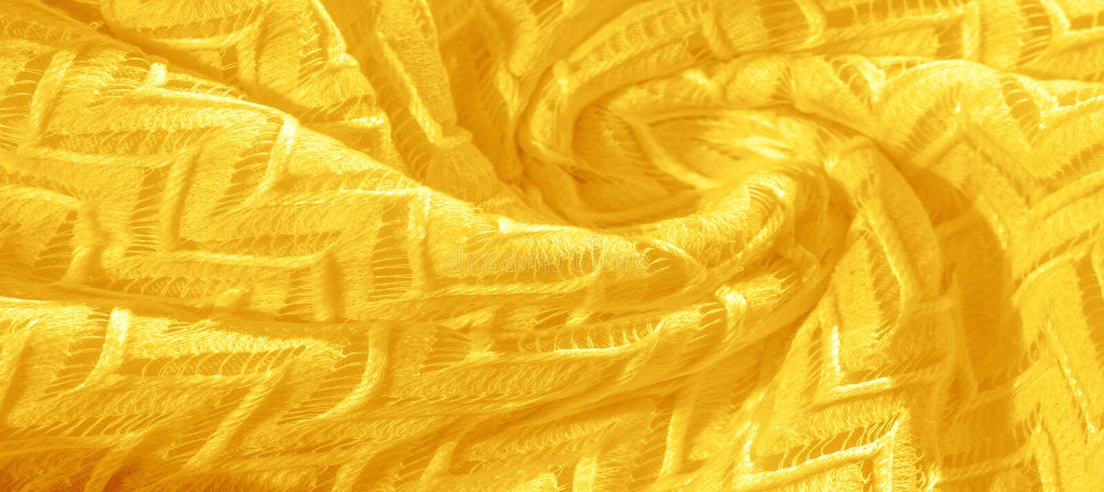 Texture, background, pattern, silk fabric, yellow, layered lace tulle, premium plain winter diamond knitted scarf in the form of. Infinity loops royalty free stock photography