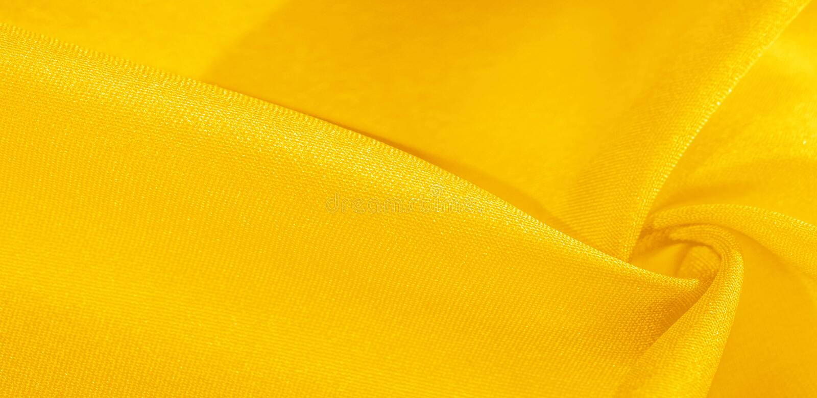 Texture, background, pattern, silk fabric in yellow. This silk is incredibly exquisite. Projects made from this will last a long. Time and will still be in royalty free illustration