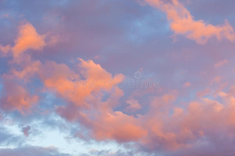 Texture, background, pattern. The sky is at sunset, dawn. Colored clouds, red, dark blue, orange, pastel colors. Romantic pastel stock photos