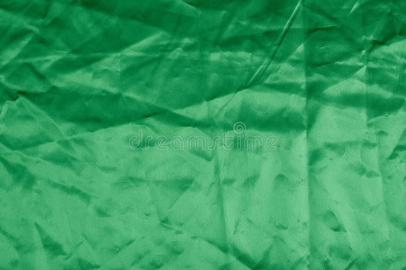 Texture, background, pattern. Texture of green silk fabric. Beau. Tiful emerald green soft silk fabric stock photography