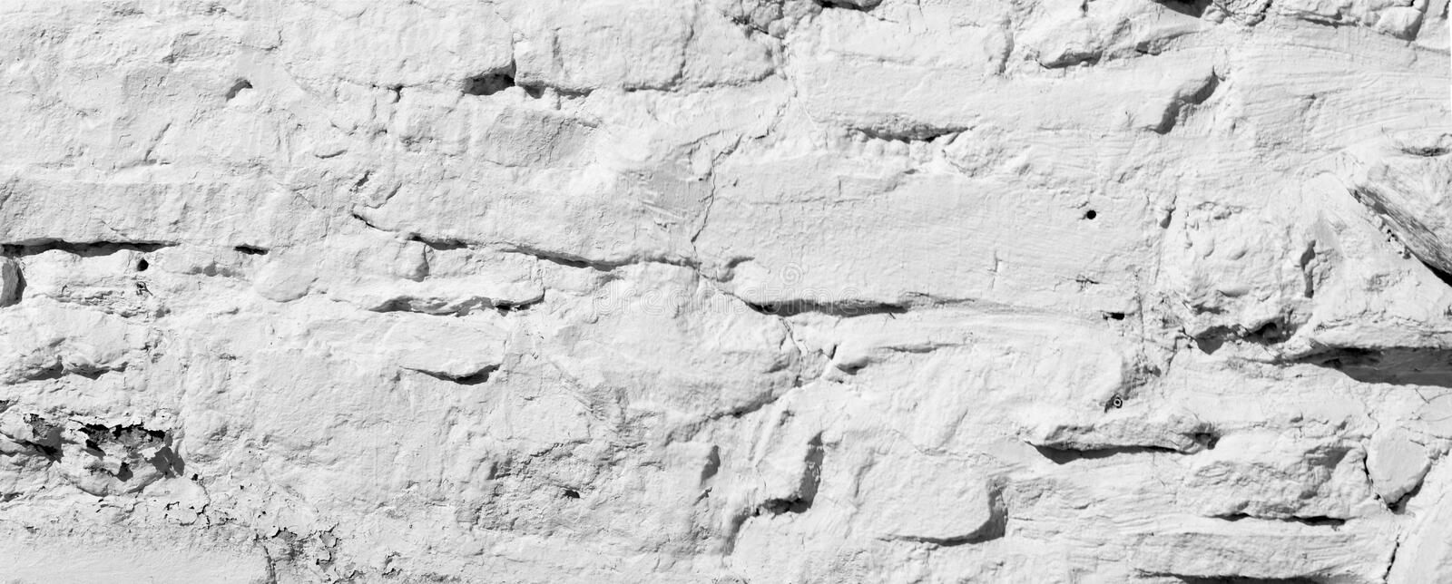 Texture background, pattern. The wall is lined with granite stones and whitewashed with lime. a continuous vertical brick or stone royalty free stock images