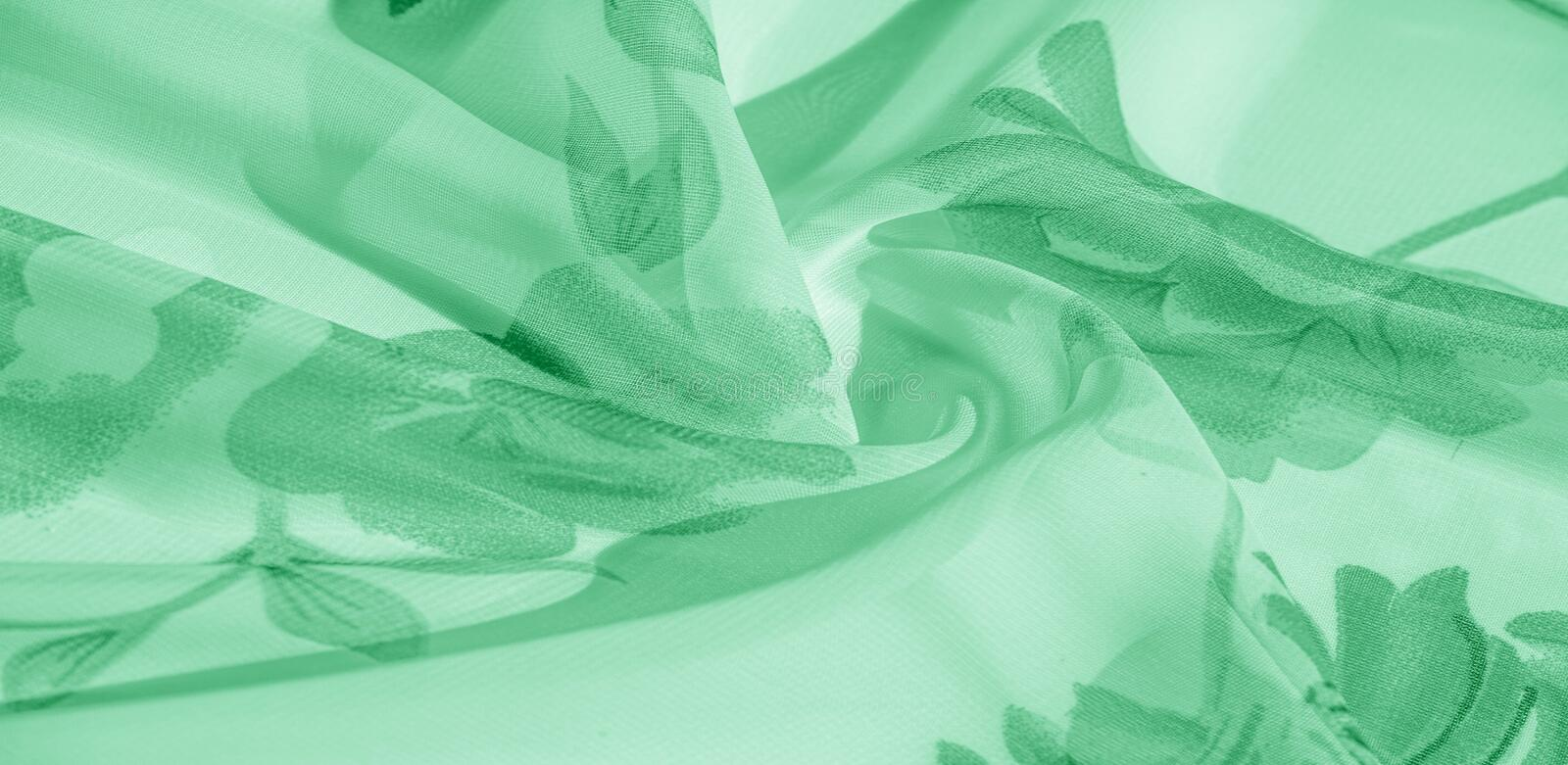Texture background, pattern, wallpaper. white silk fabric, green print. This silk lightweight fabric with a print is perfect for. Your projects, Internet decor royalty free stock image