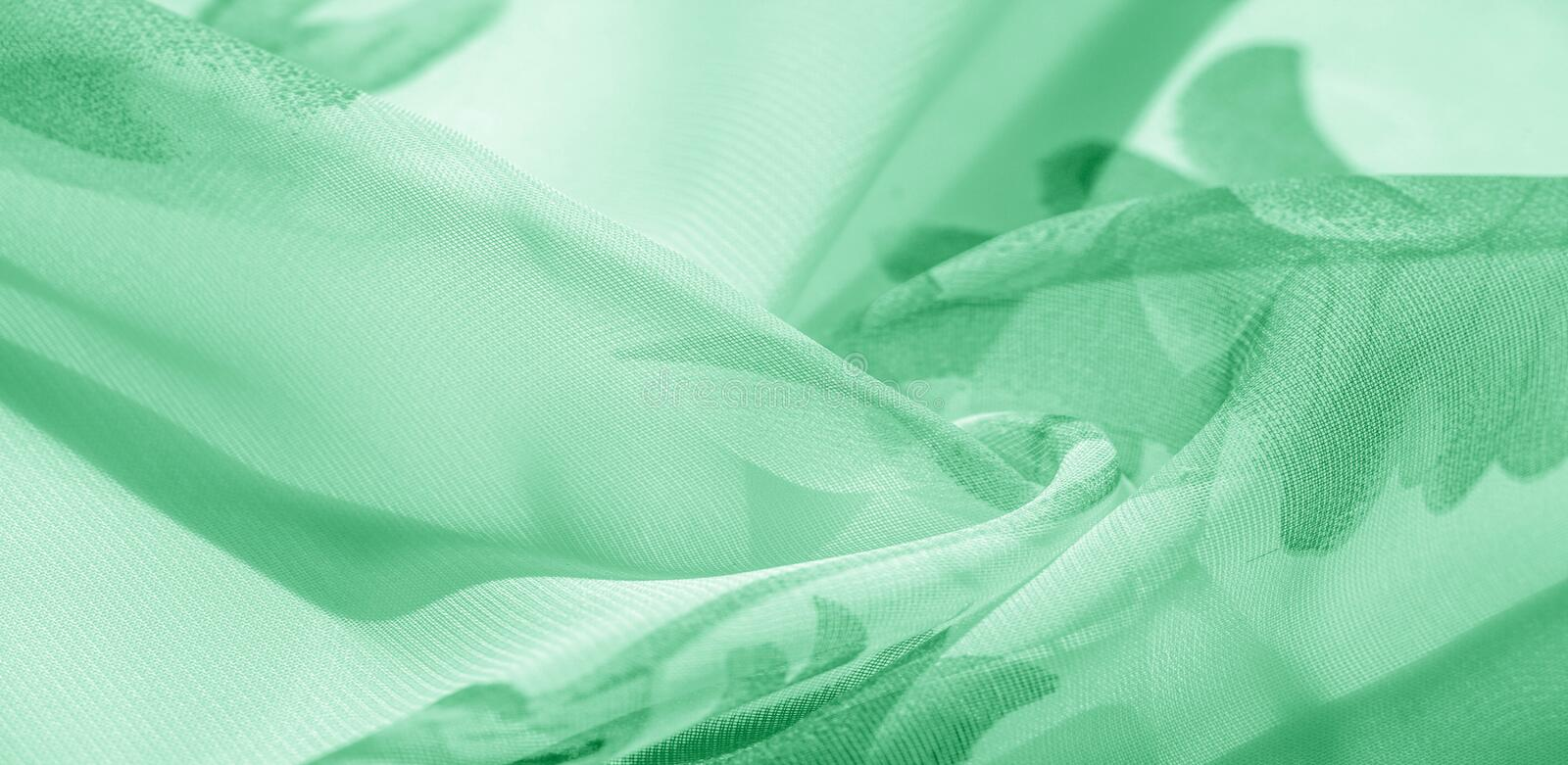 Texture background, pattern, wallpaper. white silk fabric, green print. This silk lightweight fabric with a print is perfect for. Your projects, Internet decor stock image