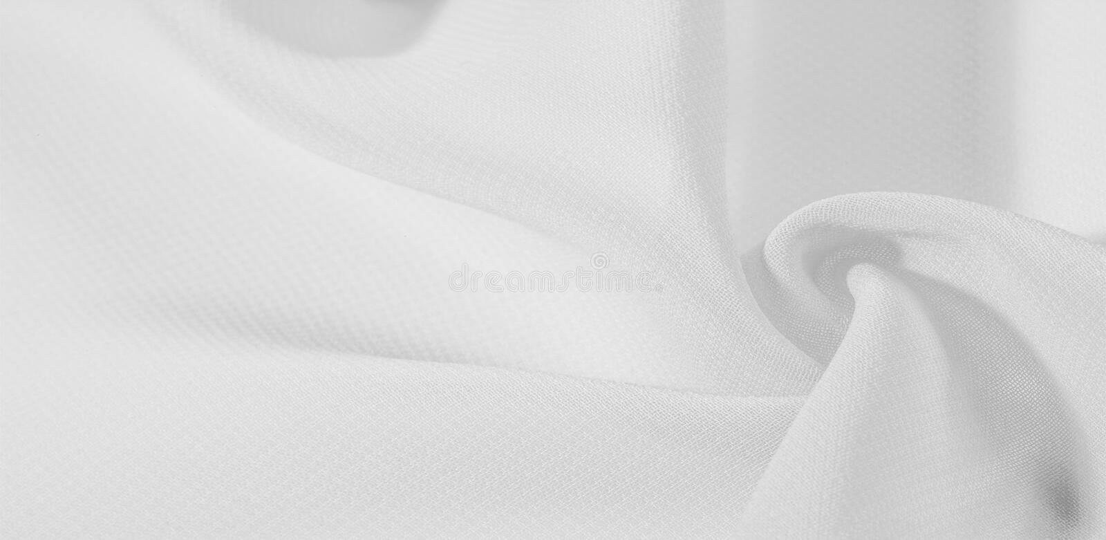Texture background pattern. White silk fabric with a subtle matte sheen. It is perfect for your design, accents, wallpapers,. Posters and postcards royalty free stock images