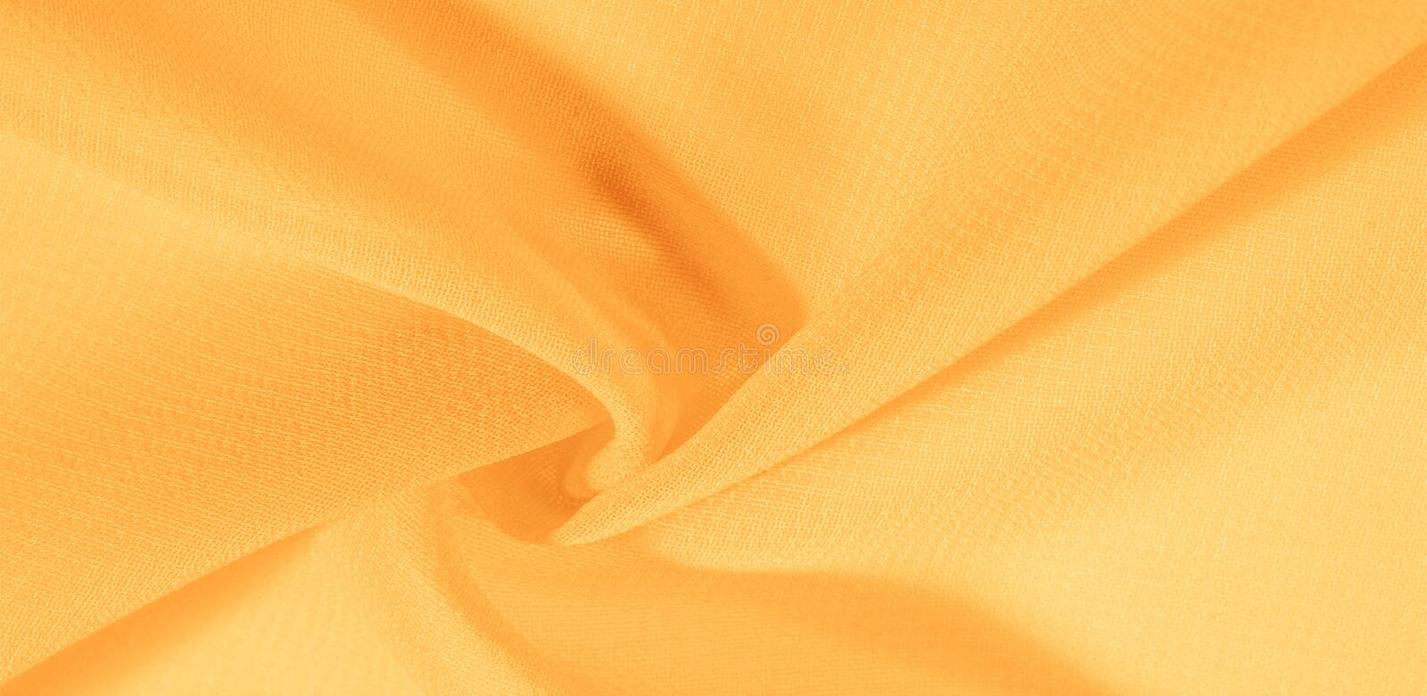 Texture background pattern. Yellow silk fabric with a subtle matte sheen. It is perfect for your design, accents, wallpapers,. Posters and postcards stock images
