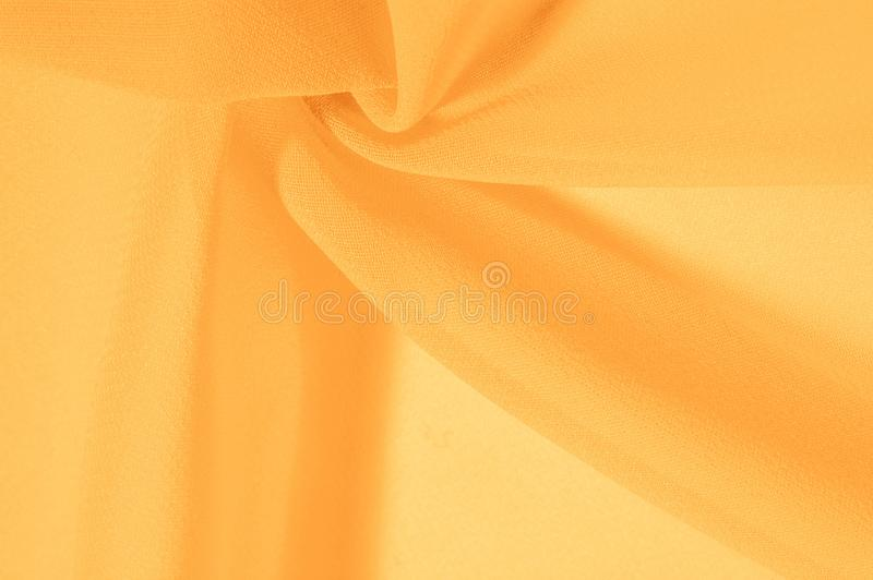 Texture background pattern. Yellow silk fabric with a subtle matte sheen. It is perfect for your design, accents, wallpapers,. Posters and postcards royalty free stock photos