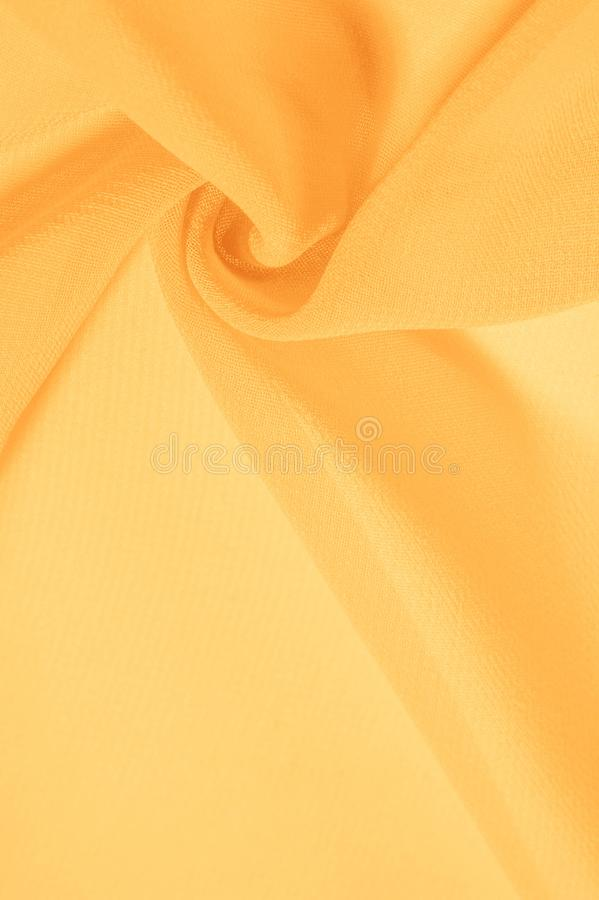 Texture background pattern. Yellow silk fabric with a subtle matte sheen. It is perfect for your design, accents, wallpapers,. Posters and postcards royalty free stock image