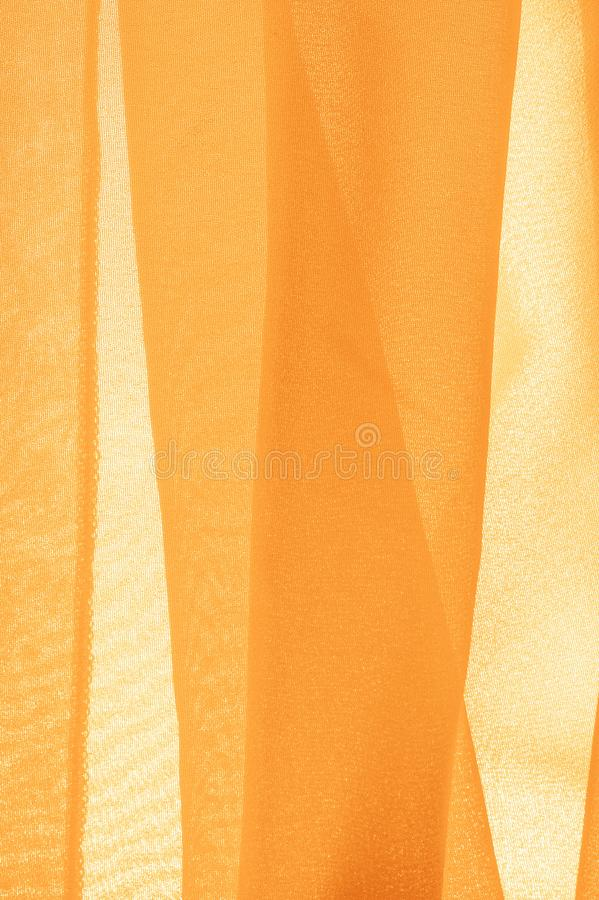 Texture background pattern. Yellow silk fabric with a subtle matte sheen. It is perfect for your design, accents, wallpapers,. Posters and postcards royalty free stock photo