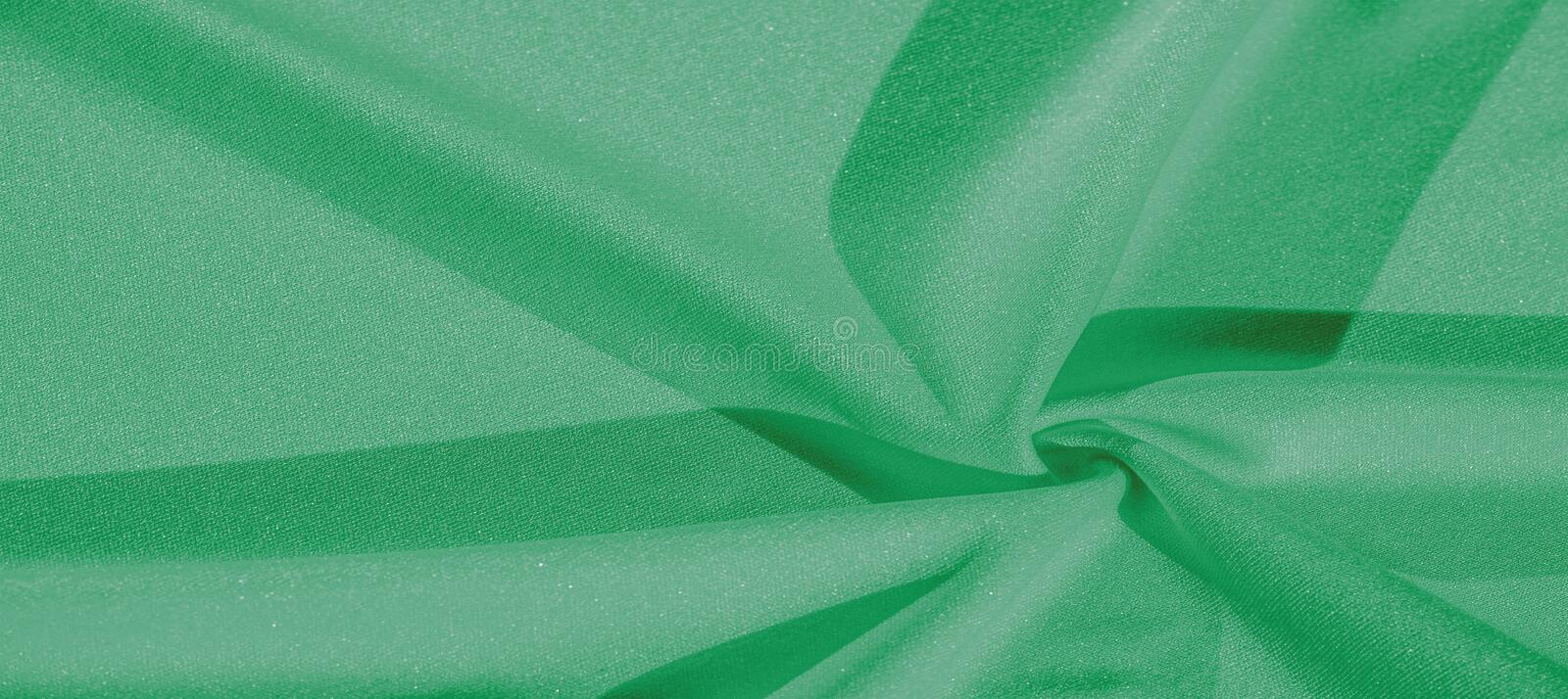 Texture, background, silk fabric, green women`s shawl Convenient for your projects, the design of wallpaper cards. Texture, background, silk fabric, green women` stock images