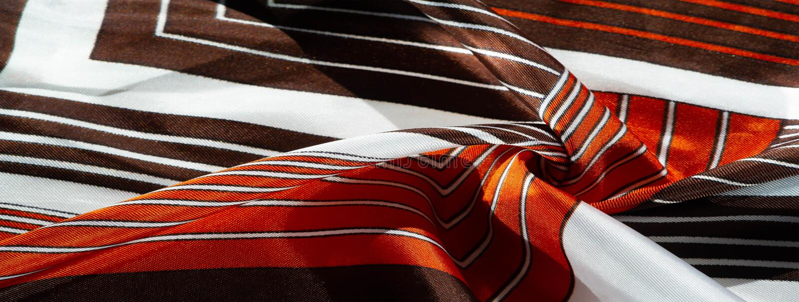 Texture, background, silk fabric with a striped pattern The design of this fabric is dedicated to the White Rabbit patchwork-style. `mosaic`, presenting how a royalty free stock image