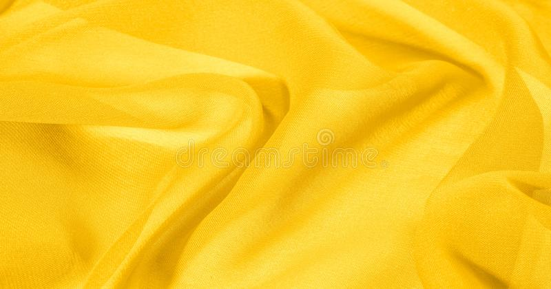 Texture, background, The silk fabric is yellow. This yellow stamping silk crepe de China is here to charge your design! Live combi. Nation of floral and paisley royalty free stock photography
