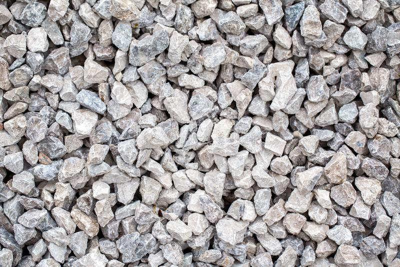 Texture background of small cracked stones rocks pavement stock images