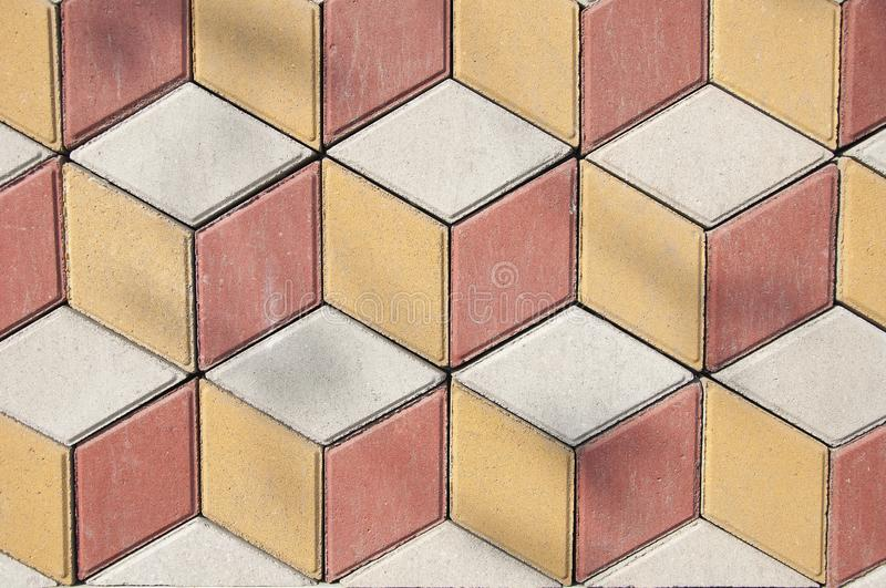 Texture and background of stone. Yellow and red with gray pavement tiles. stock image