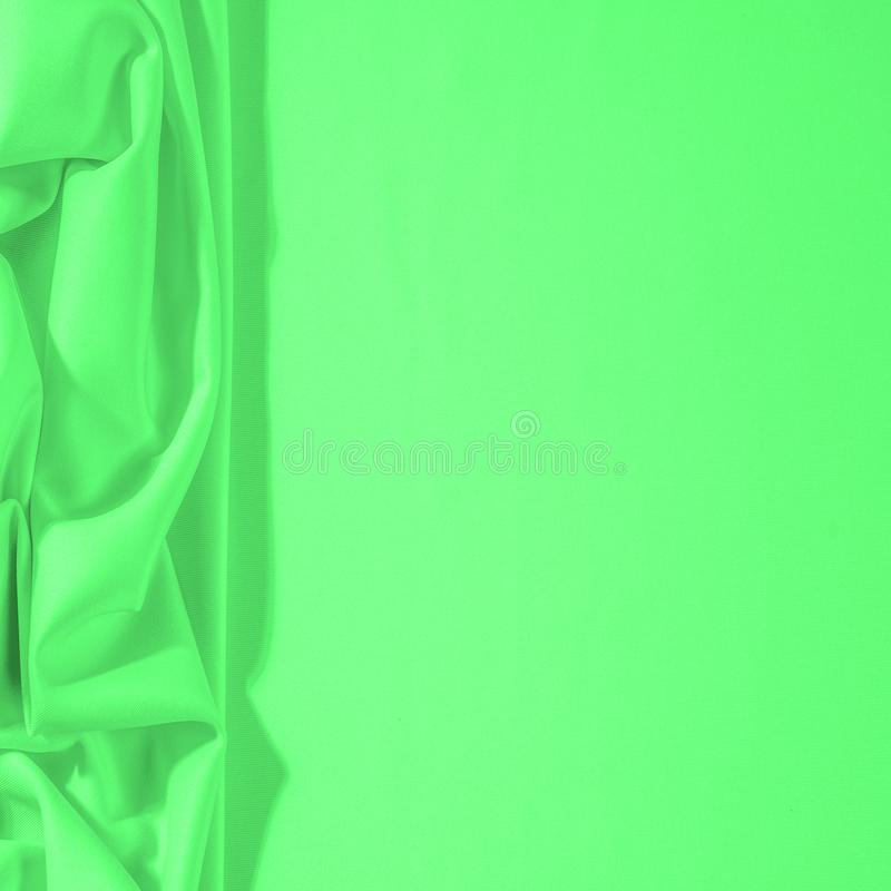 Texture. Background. Template. Cloth - silk green. Known extravagance, this Green silk taffeta is nothing more than a word. Luminous light green fabric is a royalty free stock image