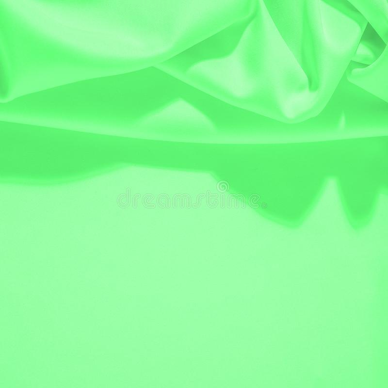 Texture. Background. Template. Cloth - silk green. Known extravagance, this Green silk taffeta is nothing more than a word. Luminous light green fabric is a stock image