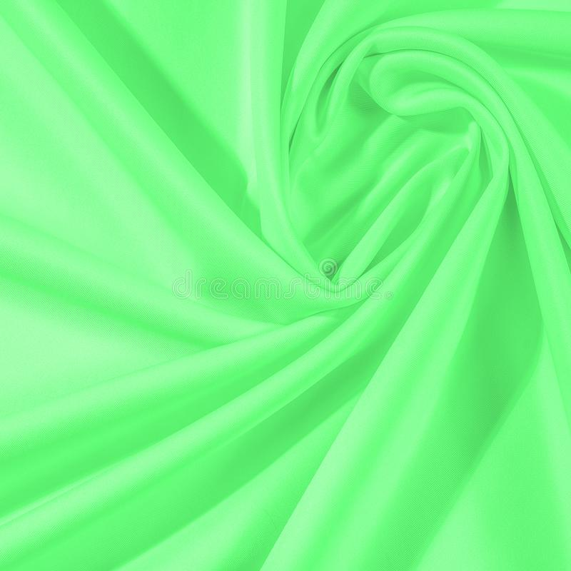 Texture. Background. Template. Cloth - silk green. Known extravagance, this Green silk taffeta is nothing more than a word. Luminous light green fabric is a royalty free stock photos