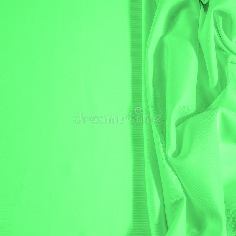 Texture. Background. Template. Cloth - silk green. Known extravagance, this Green silk taffeta is nothing more than a word. Luminous light green fabric is a stock images