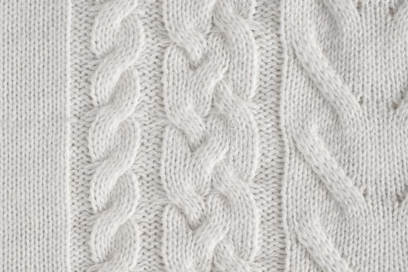 Texture Background Of White Knitted Fabric With Patterns. Close Up Of Texture Background Of White Knitted Fabric Of Wool With Patterns Top View stock image