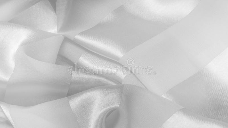 Texture, background, white silk striped fabric with a metallic sheen. If you have a bad mood, this fabric will lift it to. Unprecedented heights. Your project stock photo
