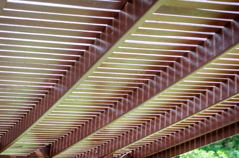 Texture background of wooden plank. Wooden slat roof coverred walkway shown line of plank and shadow stock images