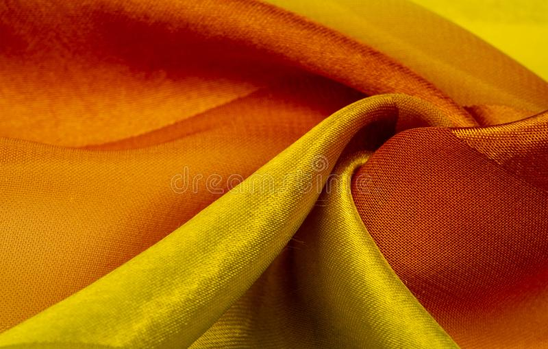 Texture, background, yellow silk striped fabric with a metallic sheen. If you have a bad mood, this fabric will lift it to. Unprecedented heights. Your project royalty free stock image