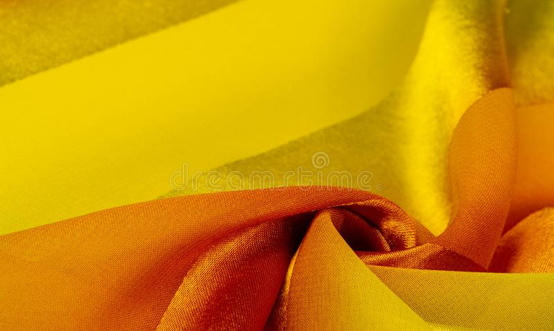 Texture, background, yellow silk striped fabric with a metallic sheen. If you have a bad mood, this fabric will lift it to. Unprecedented heights. Your project royalty free stock images