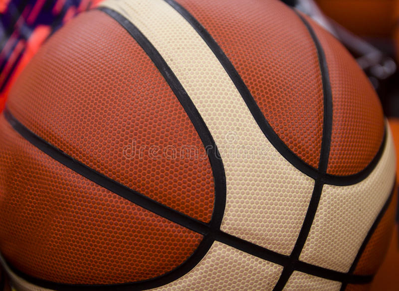 The texture of a basketball. Texture basketball ball closeup as background, texture stock images