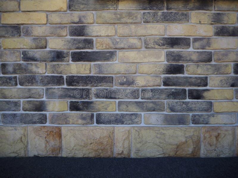 Texture beige et noire de fond d'abrégé sur mur de briques photo libre de droits