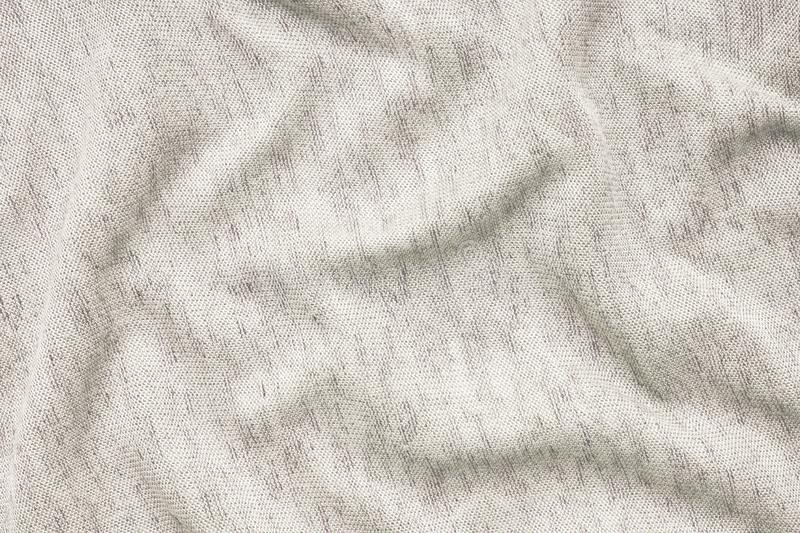 Texture of beige fabric. Background of clothing details stock image
