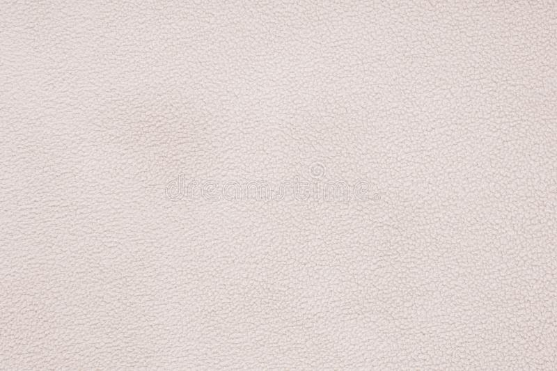 Texture of beigesoft material. Background details Terry cloth.  stock photo