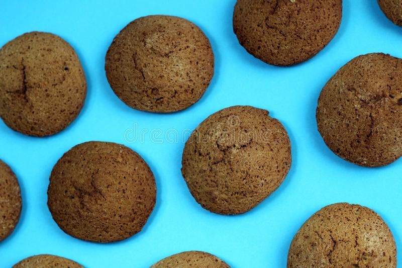 Texture of oatmeal cookies close-up tasty brown color on blue background stock image