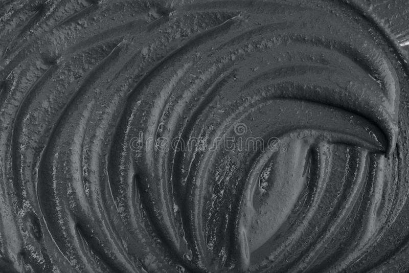 Texture of black clay mask. Cream to the face and body closeup. May use as background royalty free stock photos