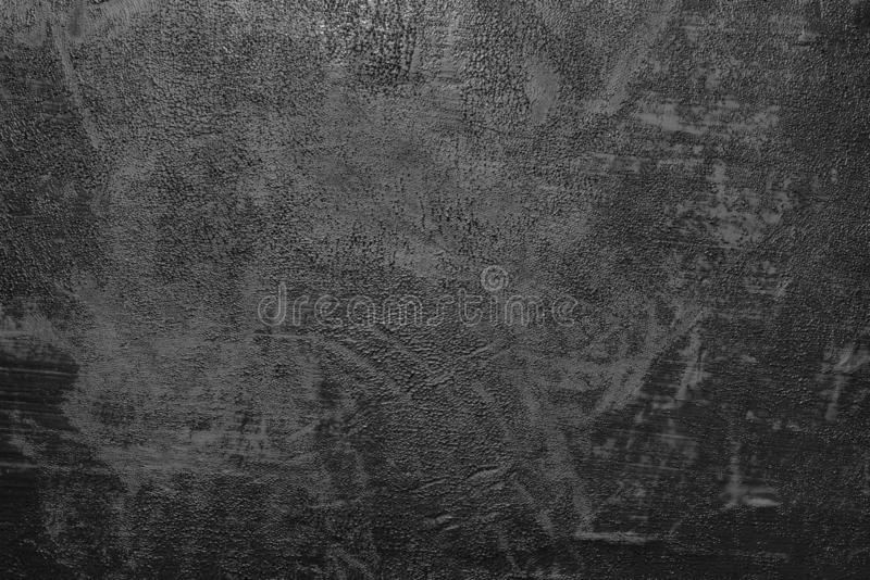Black paint smeared on the wall. Dark background, substrate for work. Texture black paint smeared on the wall. Dark background, substrate for work stock photography