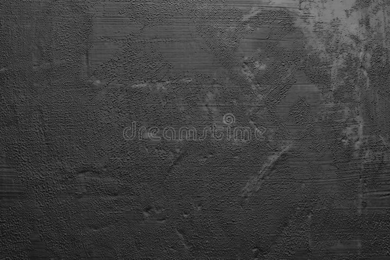 Black paint smeared on the wall. Dark background, substrate for work. Texture black paint smeared on the wall. Dark background, substrate for work stock photo