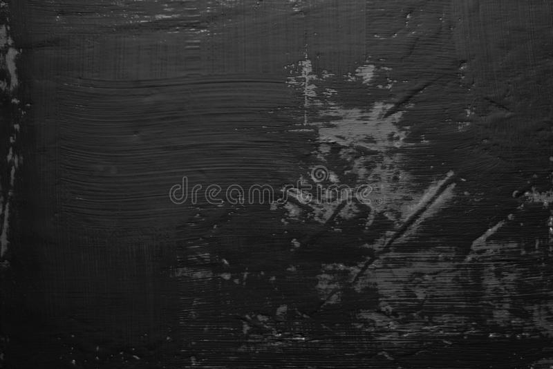 Black paint smeared on the wall. Dark background, substrate for work. Texture black paint smeared on the wall. Dark background, substrate for work royalty free stock photo