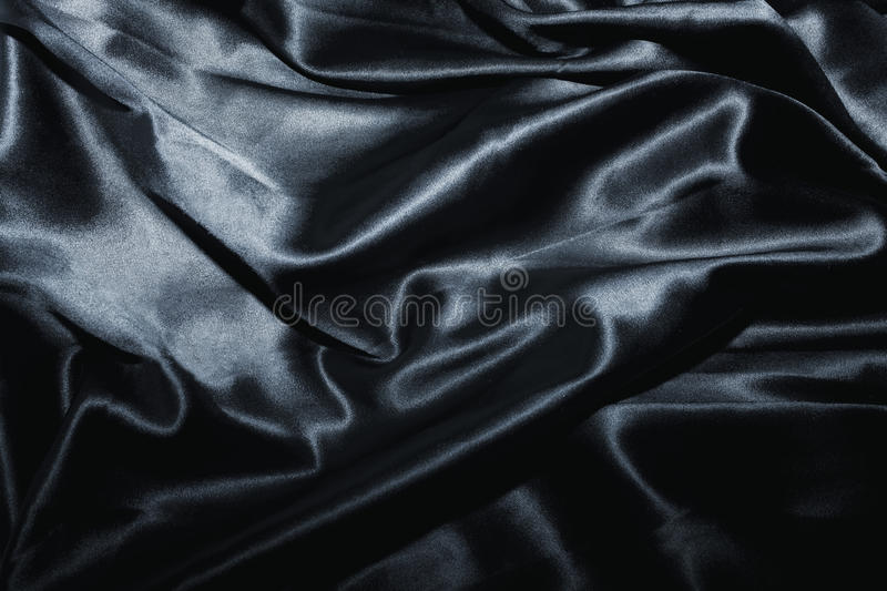 Texture of a black silk. Close up royalty free stock photography