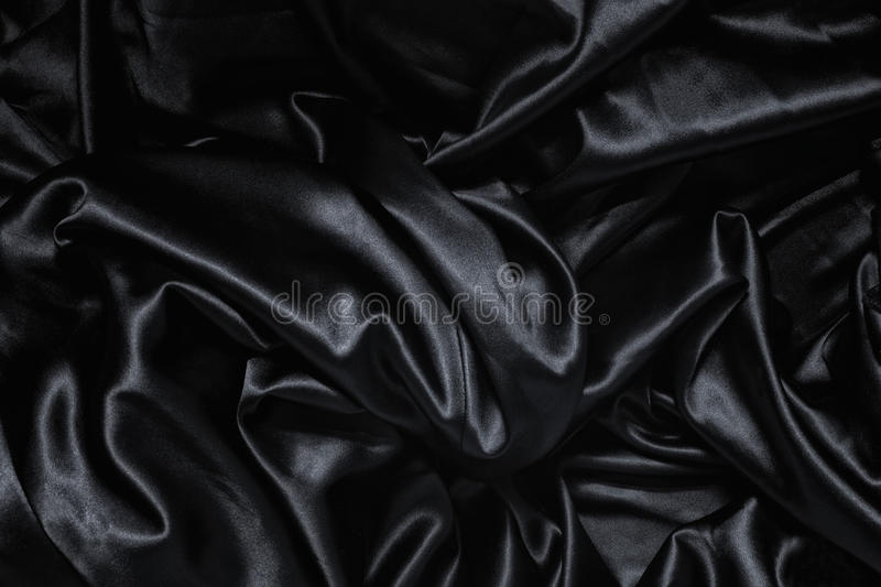 Texture of a black silk. Close up royalty free stock images
