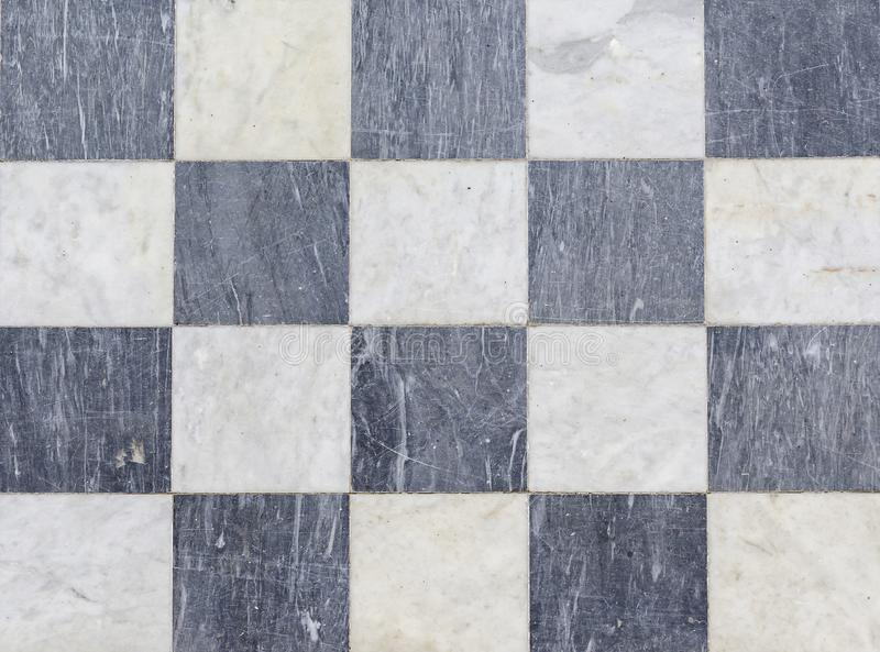 Texture black and white checkered floor tiles, background stock photography