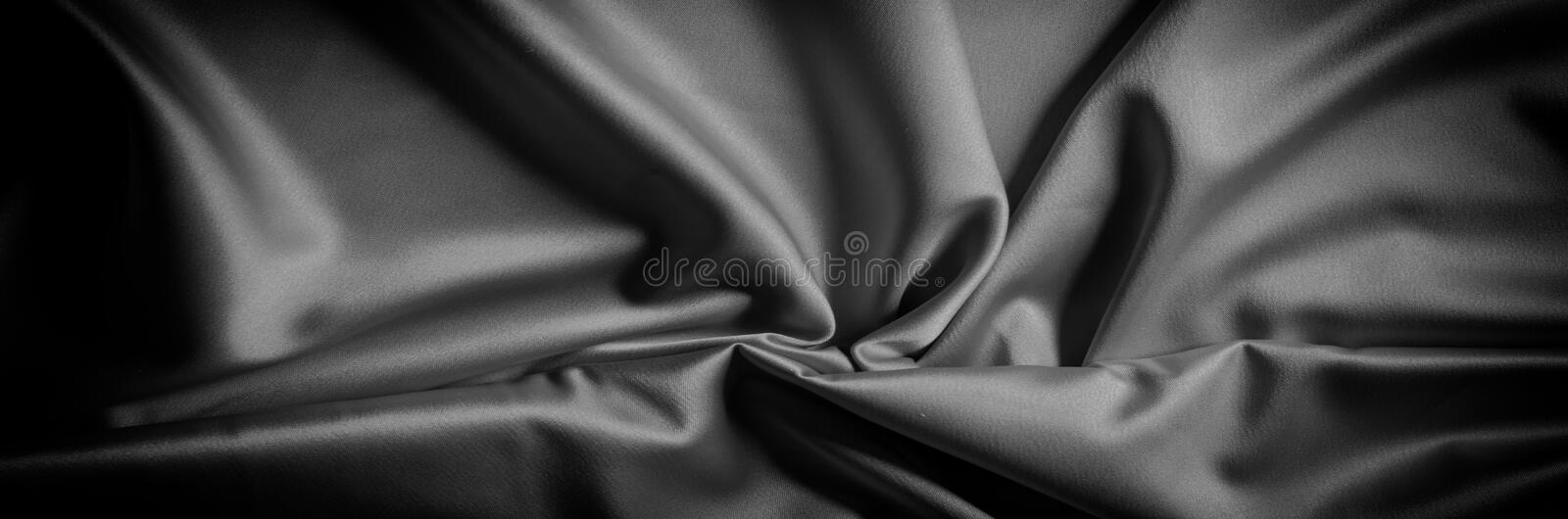 Texture of black and white silk fabric This high-quality charme. Use is made of satin weave, yet elastic and beautifully adorns. The front of the fabric has a vector illustration