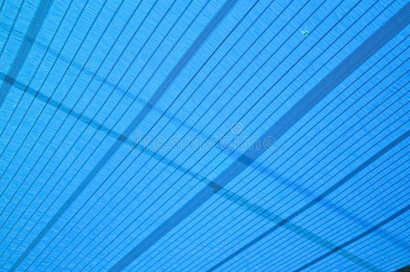 Texture bleue de filet d'ombrage photos stock