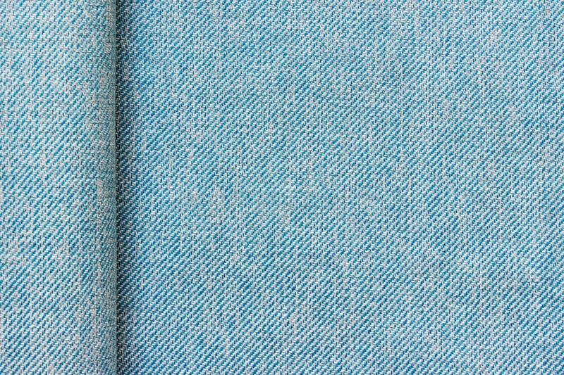 Texture of blue fabric cloth textile with a fold and copy blank space. Texture of expensive classical high quality blue fabric cloth textile material with a fold stock photos