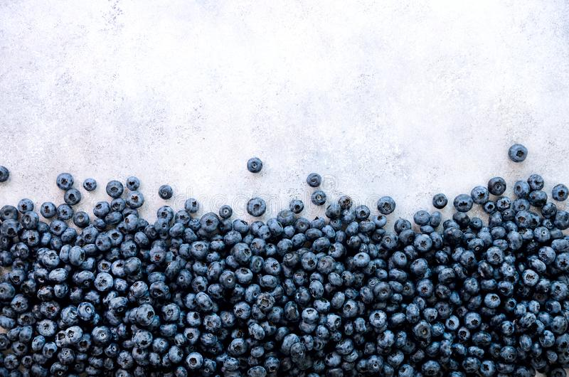 Texture of blueberry berries close up. Border design. Fresh blueberries background with copy space for your text. Vegan stock image