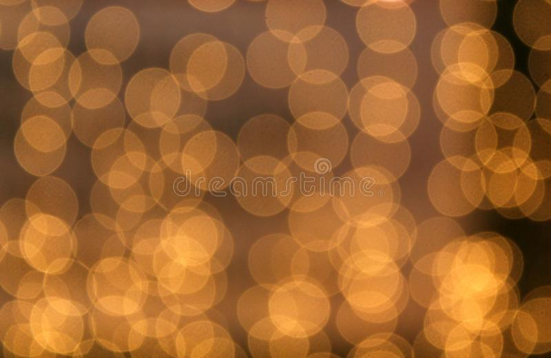 Texture blurred brown background transparent yellow circles. Christmas, background, yellow, bokeh, lights, gold, abstract, light, glitter, color, decoration royalty free stock photo