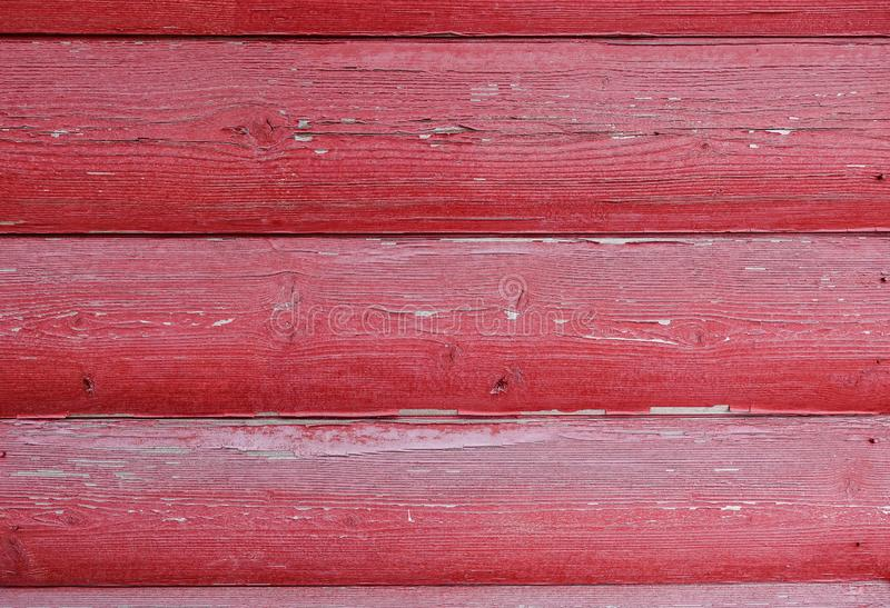 The texture of the board with peeling paint. Abstract background for design. Red rounded boards . Wall panel royalty free stock photography