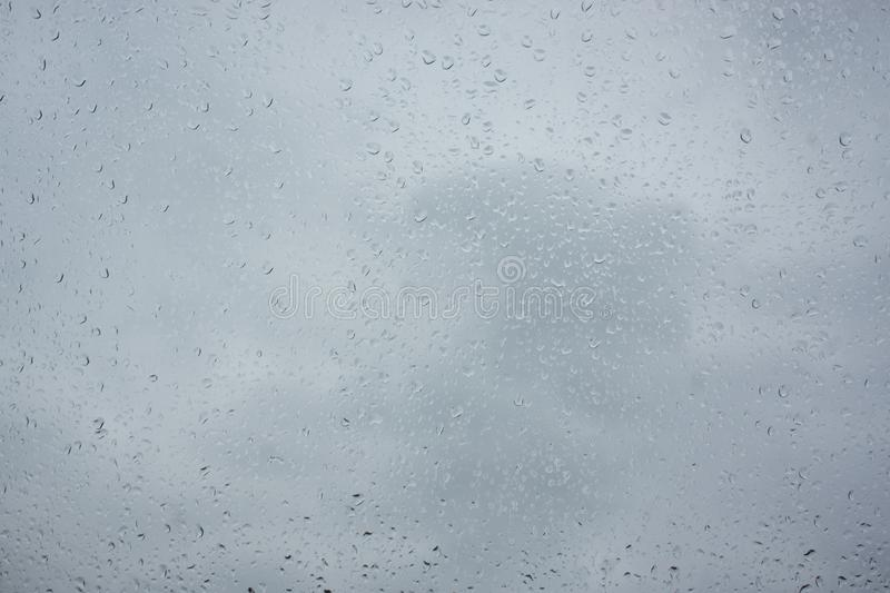 Texture of bokeh drops on glass in front of sky royalty free stock images